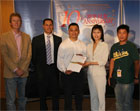 Mr. Tom Chan (third from left) receives the prize from Ms Doris Cheung, Director of the Hong Kong Economic and Trade Office in San Francisco.  Also pictured here are representatives from KRON 4, Bay Area News Station and Ming Pao Daily.