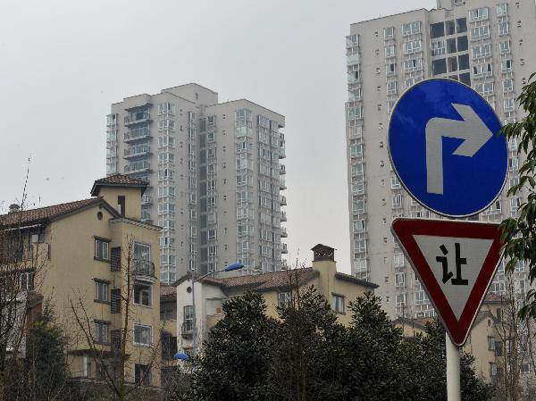Chinas Chongqing Shanghai Launch Property Tax To Cool Housing Market